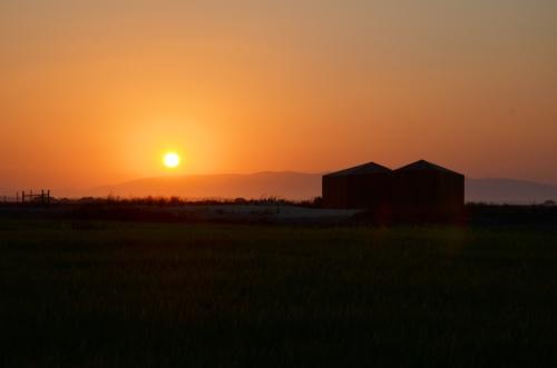 Cabanas no Rio Comporta puesta de sol